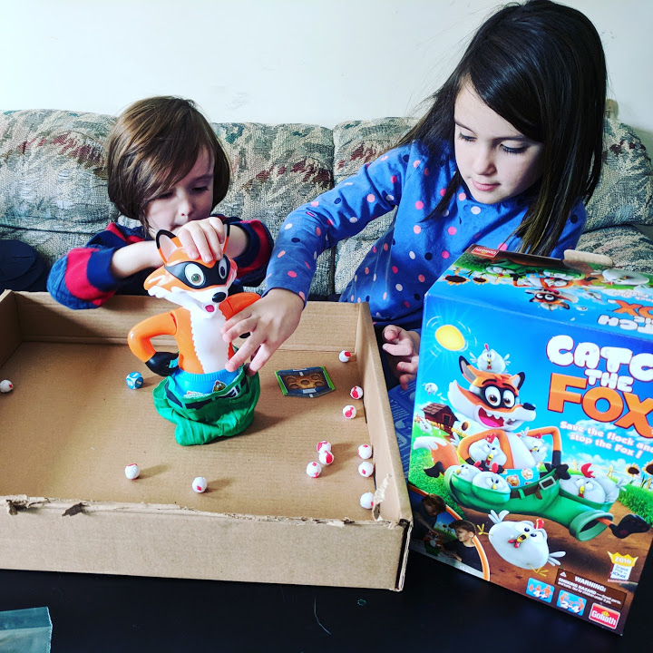Kids playing Catch the Fox board game together