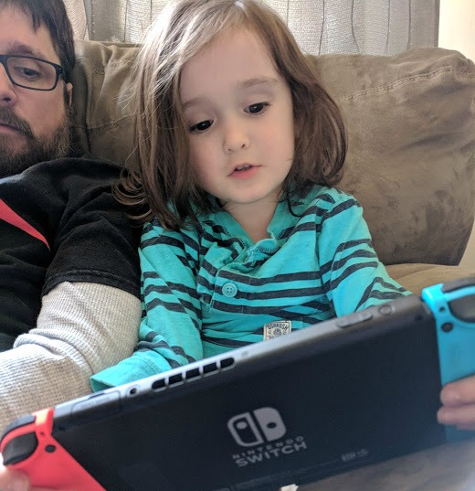 Brian and Xander looking at Nintendo Switch