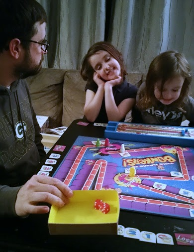 Brian playing Bonkers board game with the kids.