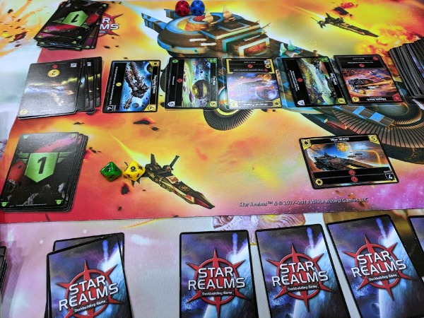 Star Realms deck building game set up with game mat.