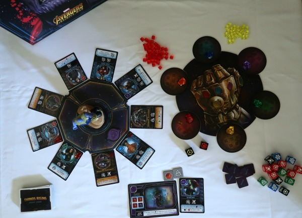 Overhead view of the Thanos Rising board game set up.