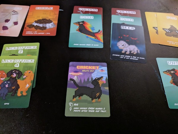 Making set combinations while playing the Doxie Dash family card game.