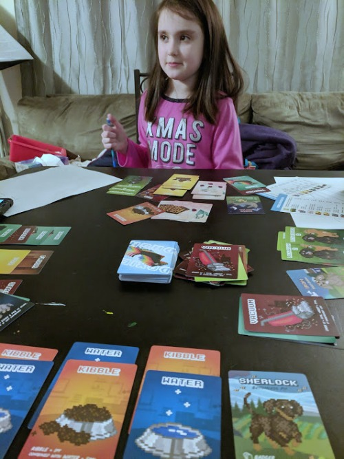 My daughter playing Doxie Dash during family game night.