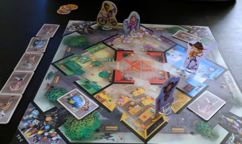 Playing cooperative family legacy board game Zombie Kids Evolution