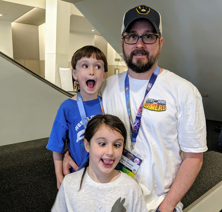 Brian and the kids making silly faces at Origins Game Fair 2019